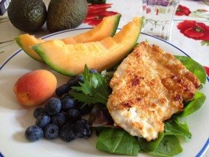 Parmesan Chicken with leaves, berries, melon